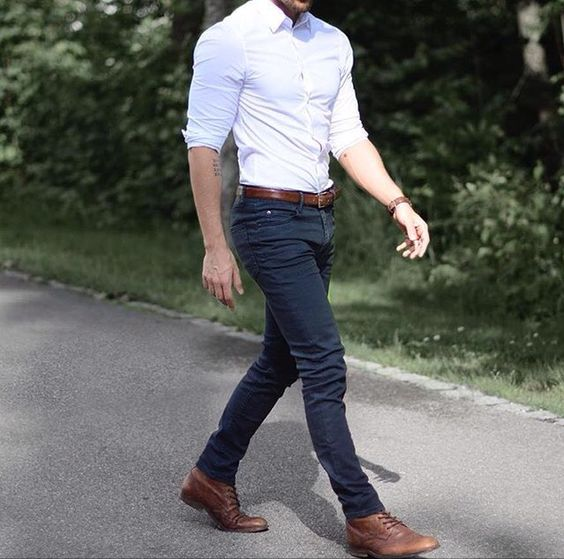 navy jeans, a white fitted shirt and brown leather shoes
