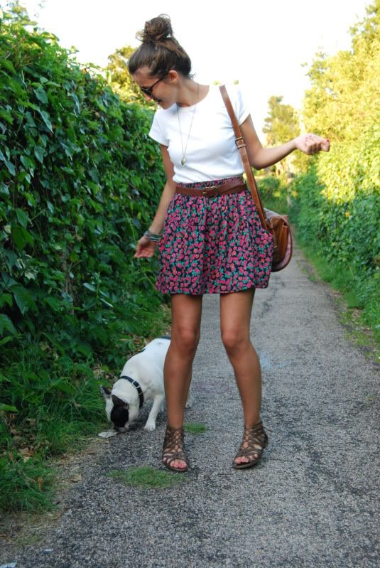a bold floral mini, a white tee, lace up sandals