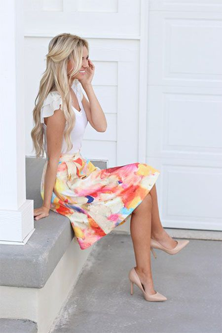 a bold marbleized midi skirt, a white tee and nude heels