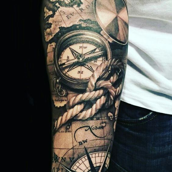 a part of a tattoo sleeve with rope and compasses