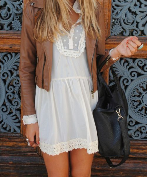 a white lace mini dress and a cognac leather jacket