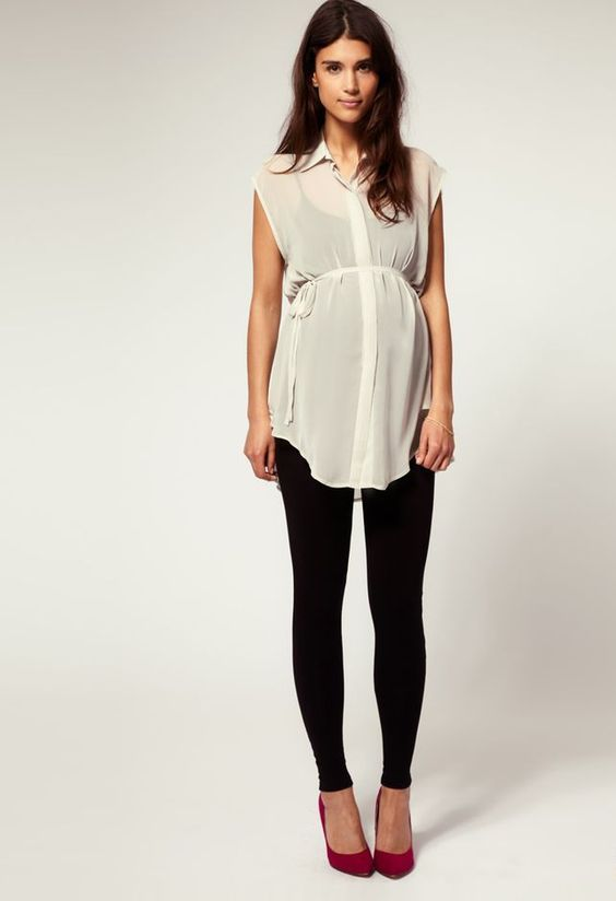 black leggings, a black top, a sheer ivory tunic and red heels for a comfy feel