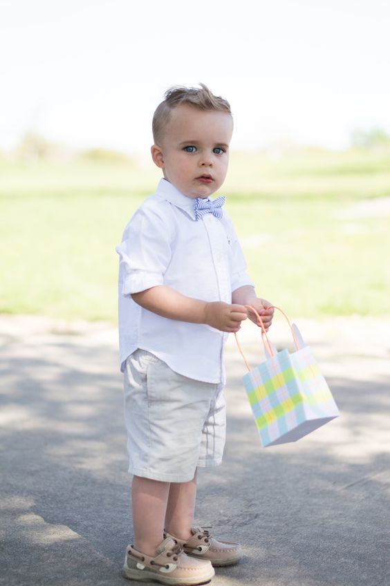 brown shoes, grey shorts, a white shirt and a striped bow tie