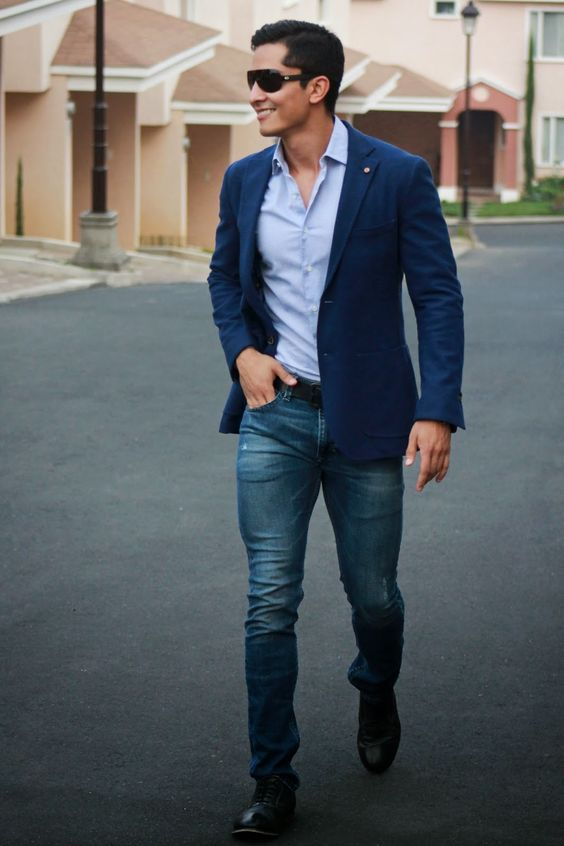 jeans, a blue shirt, a bold blue jacket and black shoes