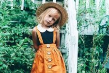 04 a black and white top, a yellow overall and vintage boots