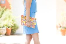 04 a blue scalloped top and a mini skirt, nude heels and a floral applique clutch