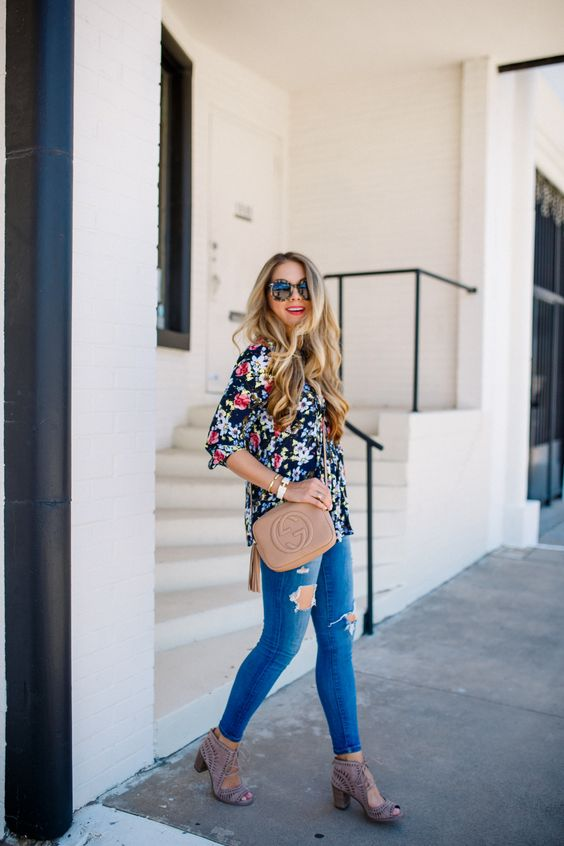 a bold floral blouse with distressed skinny jeans and blush cut out shoes