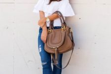 04 a white off the shoulder ruffled top, ripped jeans, brown heel sandals and a bag