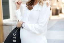 04 a white shirt and black jeans, a black tote and flat booties