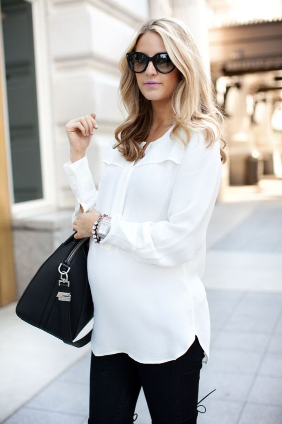 a white shirt and black jeans, a black tote and flat booties