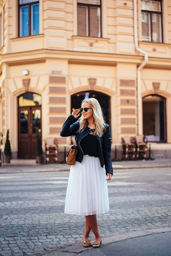 a white tulle skirt, a black tee, a black leather jacket and flats
