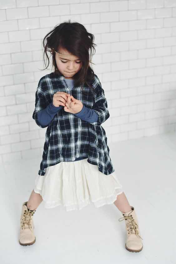 casual look with an ivory skirt, a checked shirt and ivory boots