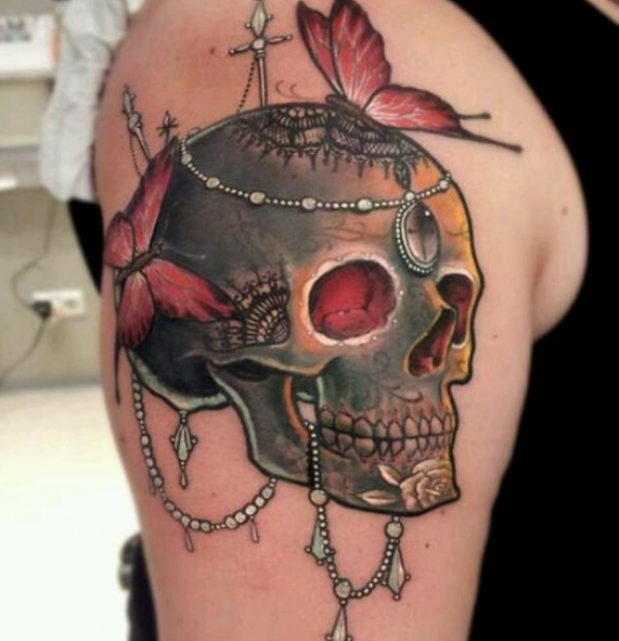 colorful beaded skull tattoo with butterflies