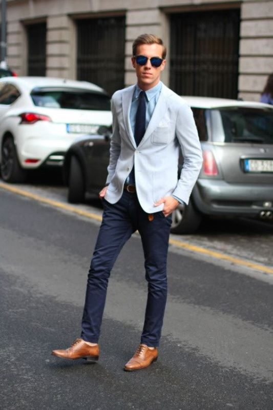 navy jeans, a light blue jacket, a blue shirt and a navy tie