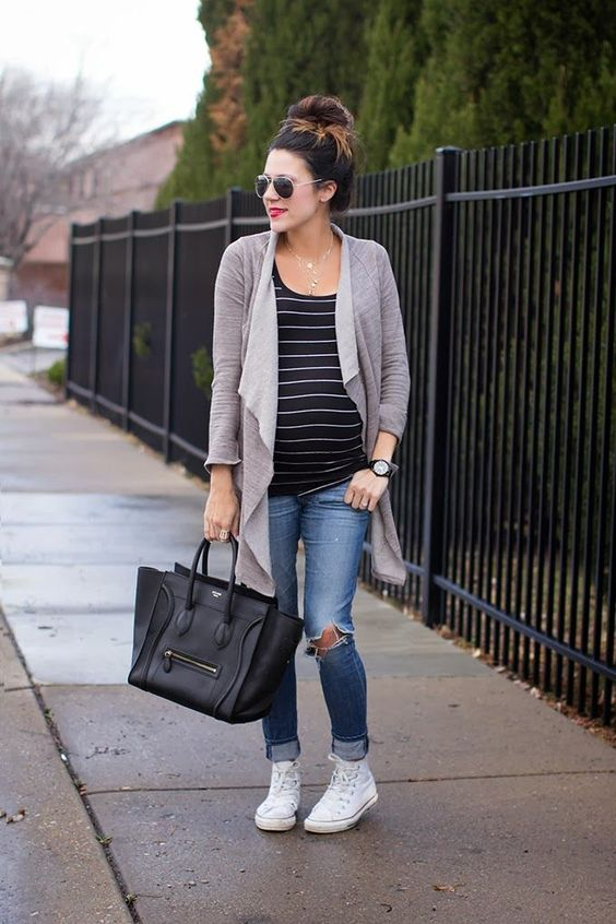 ripped blue jeans, a striped tee, a grey cardigan and white chucks
