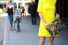 05 a bold yellow mini dress, pink heels and a floral clutch