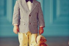 05 a checked jacket, a white shirt, a printed bow tie and yellow pants