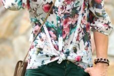 05 a floral blouse with emerald pants and a crossbody bag