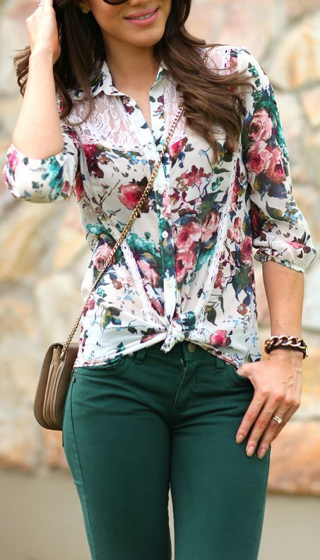 a floral blouse with emerald pants and a crossbody bag