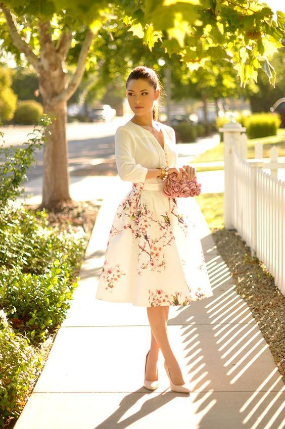 a floral midi, a white shirt, blush heels and a rose clutch