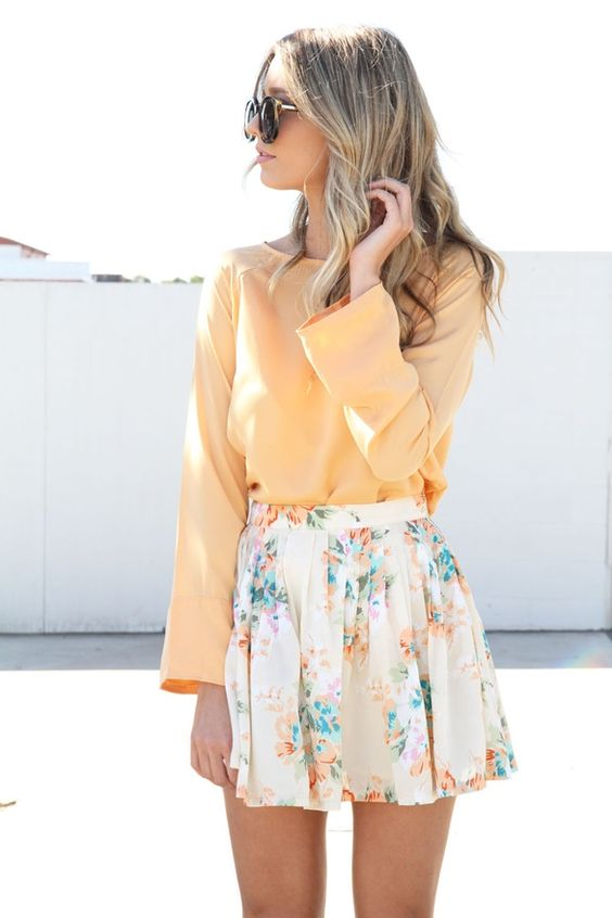 a peach long sleeve and a floral pleated mini