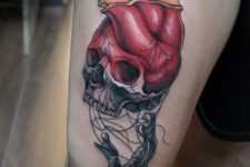 05 a skull and heart colorful tattoo on an arm