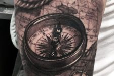 05 artistically rich 3D compass, rope and world map tattoo