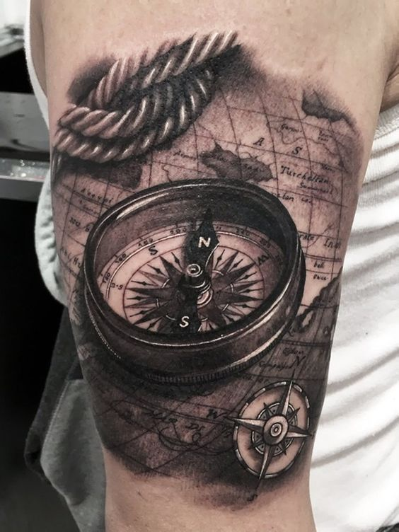 artistically rich 3D compass, rope and world map tattoo