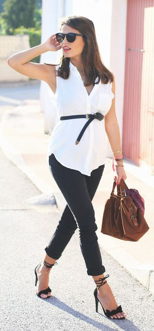 black jeans, a white tunic with a belt and black heels