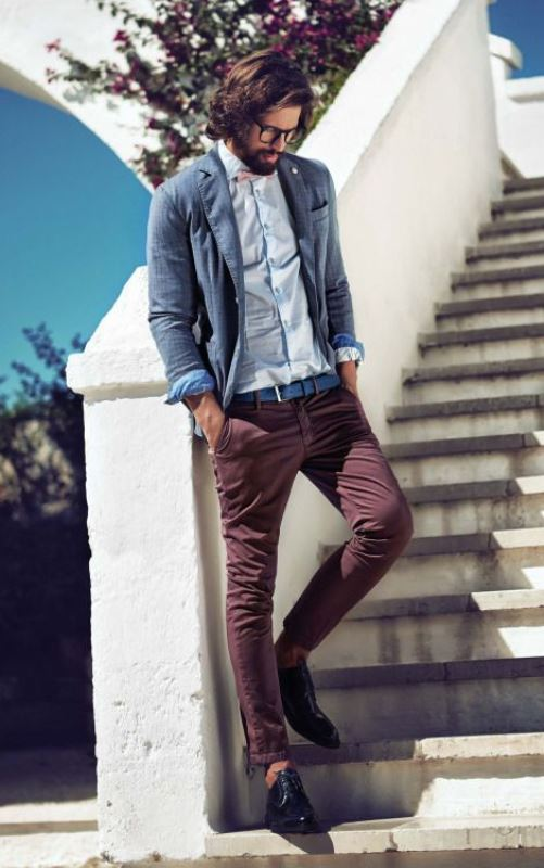 burgundy jeans, a light blue shirt and a grey jacket