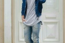 05 distressed jeans, a grey t-shirt, a blue denim jacket and yellow boots