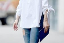 05 ripped jeans, a white off the shoulder and white sneakers