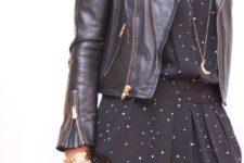 06 a black polka dot dress with a black moto jacket and a burgundy bag