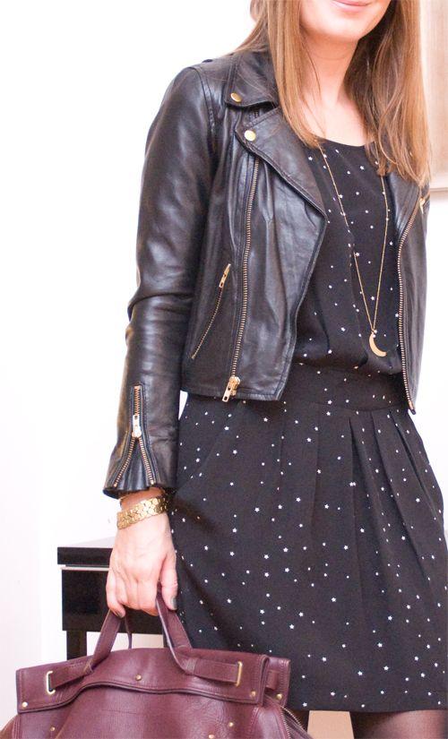 a black polka dot dress with a black moto jacket and a burgundy bag