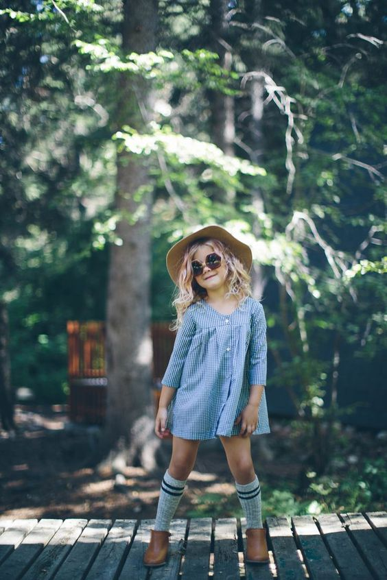 little girl look with a blue gingham dress, high socks and brown boots