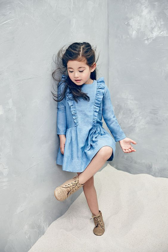 a chambray dress with long sleeves and ruffles, vintage perforated boots