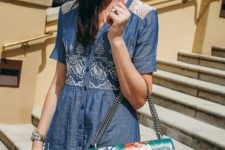 06 a chambray shirt dress with crochet lace and buttons and a large emerald floral bag