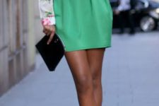 06 a green mini skirt, a floral blouse and heels