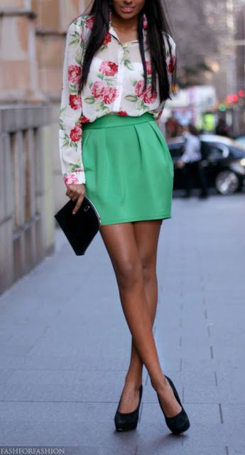 a green mini skirt, a floral blouse and heels