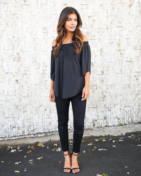 black off the shoulder top, half sleeves, black jeans and heeled sandals