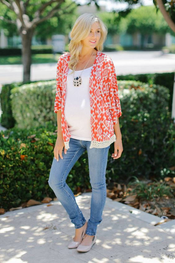 light blue skinnies, a white t-shirt, a printed coral shirt and flats