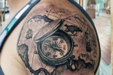 06 upper shoulder world map tattoo with a compass