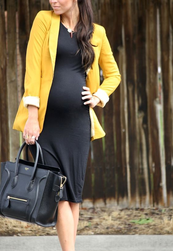 sexy maternity work outfit with a black dress and a yellow blazer plus a large black tote