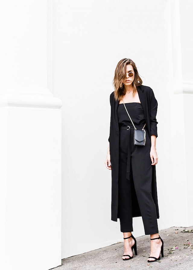 a black jumpsuit, a black long blazer and sandals