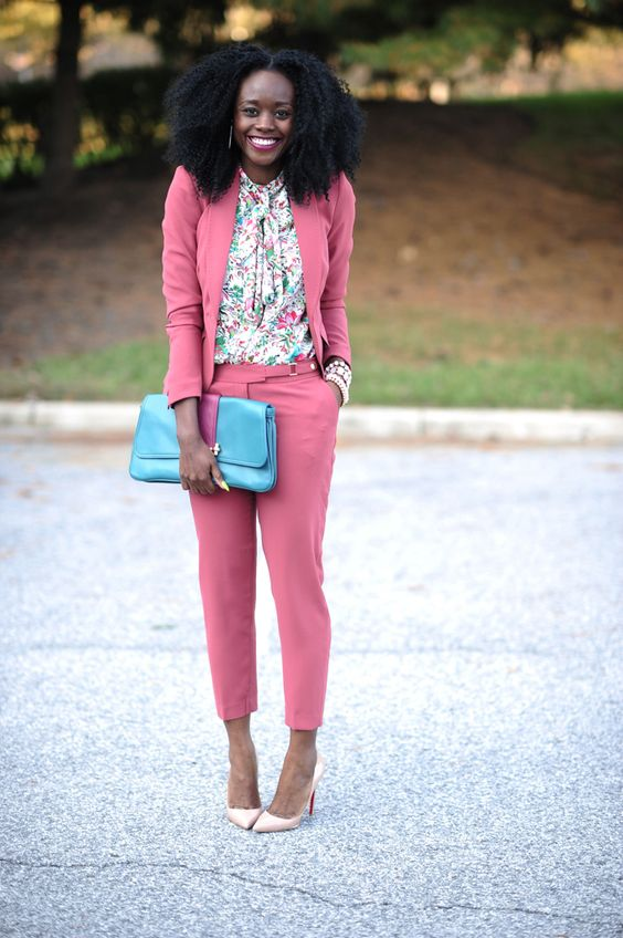 a bubble gum pink suit mixed with a floral blouse
