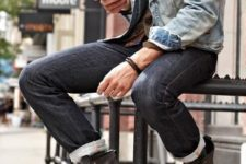 07 a distressed denim jacket, black jeans, a shirt and brown boots
