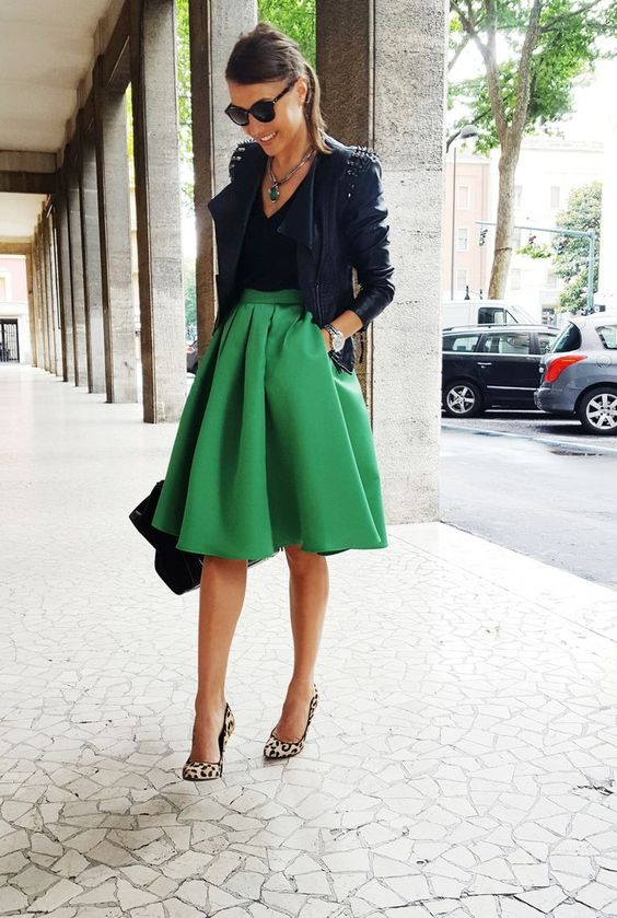 a green skirt, a black top, leopard print shoes and a black moto jacket