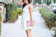07 a metallic grey dress, a floral clutch, silver strap heels