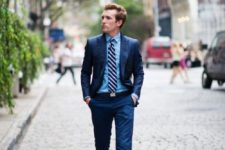 07 a navy suit, a blue shirt, a striped tie and sneakers