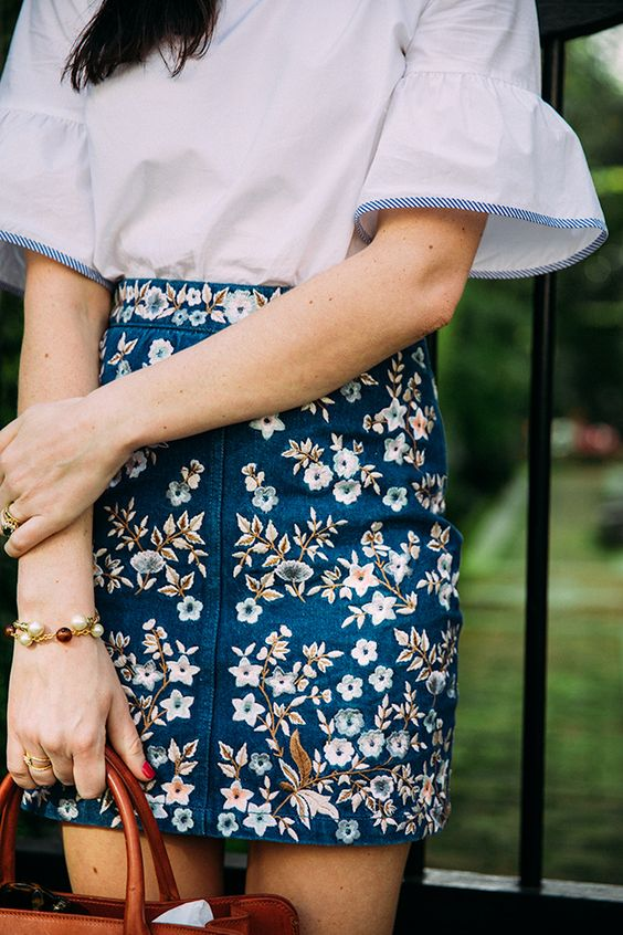 a white blouse with short sleeves and a floral denim mini